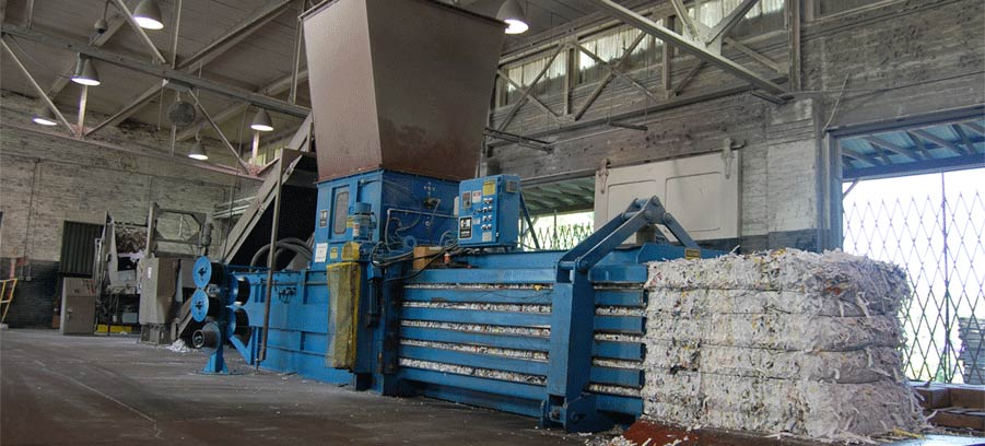 shredded paper being baled at Confidata's shredding facility