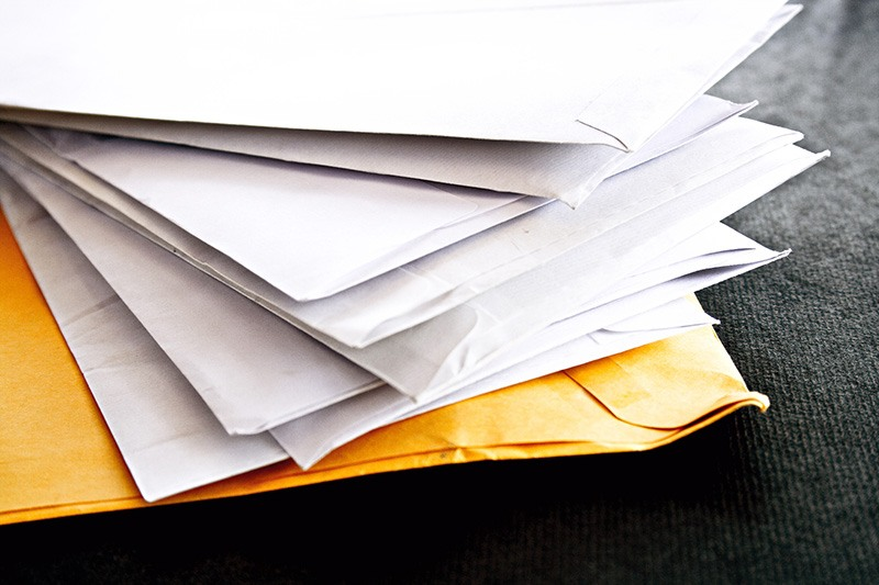 pile of junk mail waiting to be shredded