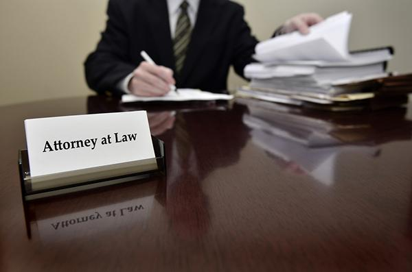 attorney at law sitting at his desk going through paperwork