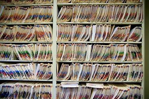 shelves filled with medical records containing personal data