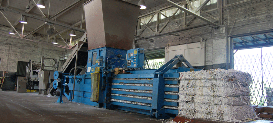 shredded paper being baled at Confidata's shredding facility